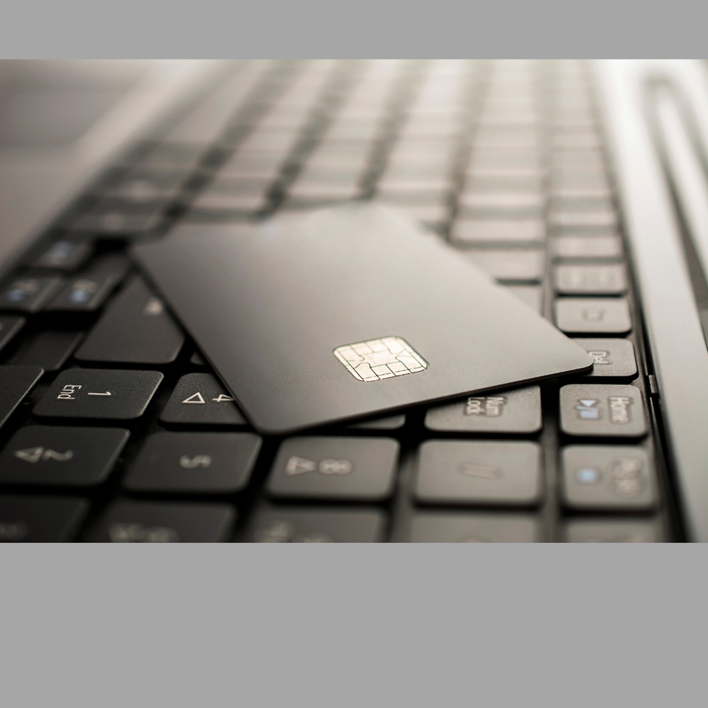 image of a credit card on a keyboard, representative of the Home Equity Line Of Credit service provided by Canadian Mortgage Broker Michelle Campbell