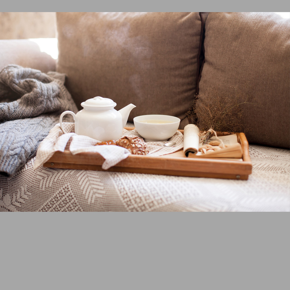 image of a tea tray setting on a couch, representative of the revers mortgage service provided by Canadian Mortgage Broker Michelle Campbell