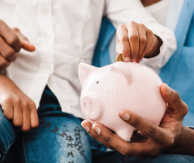image of a child holding a piggy bank, featured image for Teaching Your Kids About Finances blog post, Canadian Mortgage Broker, Michelle Campbell